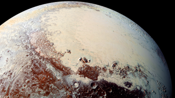 "Uma imagem colorida do Sputnik Planum, na região conhecida como ""coração"" de Plutão, que é rica em nitrogênio, monóxido de carbono e gelos de metano. Crédito NASA / Laboratório Johns Hopkins de Física Aplicada / Southwest Research Institute"