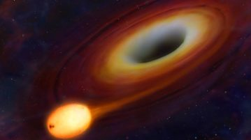 An artist's impression of the initial stages of disruption of a star as it flies close to the central black hole of a distant galaxy.